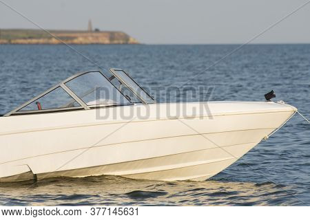 White Speed Boat Or Motor Boat In The Bay Near The Shore. Sea Trip On A Boat.