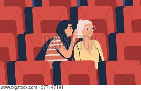 Two Young Girl Friends Whispering At Movie Theater. Women Discuss Gossip, Tell Secret, Laugh, Watch