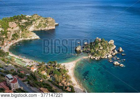 Isola Bella island near Taormina, Sicily, Italy. Narrow path connects island to mainland Taormina beach with at Ionian Sea. Beautiful seascape In Taormina, Sicily