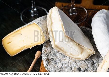 Various Types Of Cheese Composition. Gorgonzola, Camembert, Brie Cheese. Roquefort, Dor Blue. Walnut