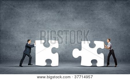 Piece of puzzle and business persons
