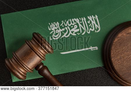 Wooden Mallet Justice On Saudi Arabia Flag. Law Library. Law And Justice Concept