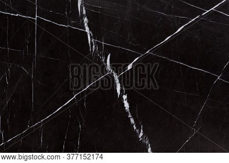 Hard Marble Background In Contrast Dark Colour.