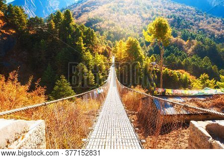 Suspension Bridge In Himalaya Mountains, Nepal. Khumbu Valley, Everest Region, Sagarmatha National P