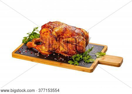 Grilled Fried Roast Chicken On Slate Cutting Board, White Background