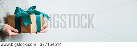 Female Hands Hold Gift Box On White Background, Copy Space Right. Unrecognizable Caucasian Girl In G