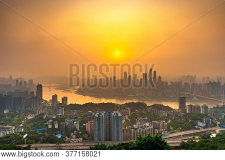 Chongqing, China downtown city skyline over the Yangtze River just before sunset.