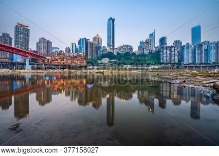 Chongqing, China skyline on the Jialing River at dusk.