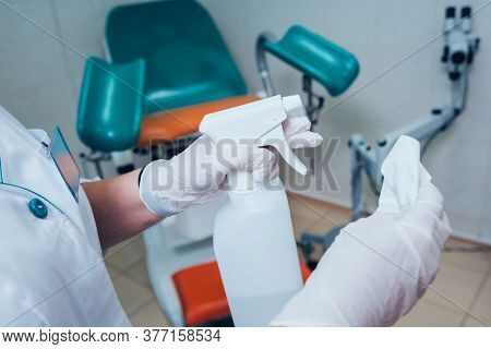 Sterilization Of Medical Surgical Instruments. Hands In Gloves