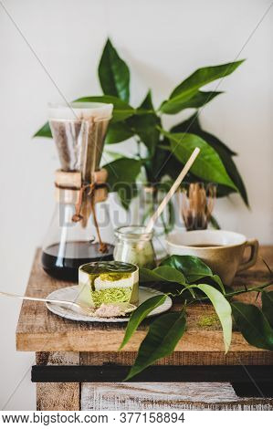 Green Matcha Cheesecake And Coffee In Flask Over Kitchen Counter