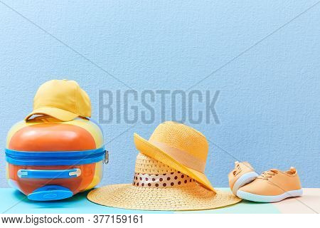 Travelling Background. Family Trip. Family Holiday. Summer Time. Suitcase, Sun Hats And Sneakers On