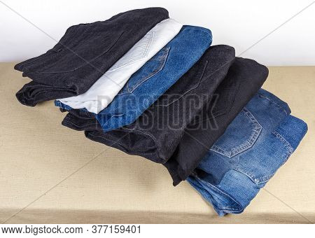 Different Pairs Of Jeans Various Colors And Textures Folded Back Pocket Up