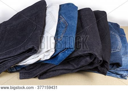 Different Pairs Of Jeans Various Colors And Textures, Folded Back Pockets Up, Fragment Close-up