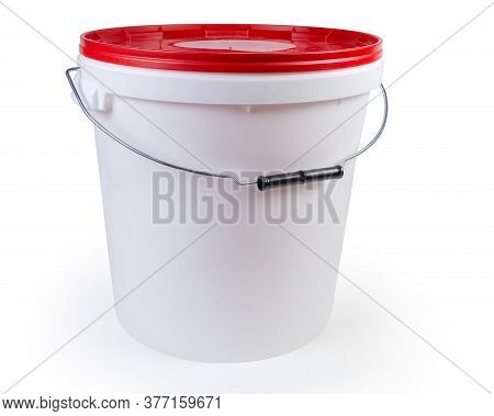 White Plastic Bucket With Metal Bail And Plastic Handle, Closed Red Lid On A White Background
