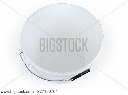 Empty White Plastic Bucket With Metal Bail And Plastic Handle On A White Background, Top View