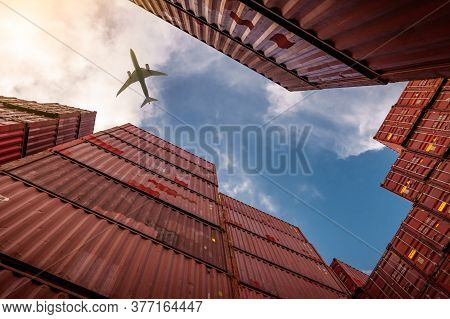 Airplane Flying Above Container Logistic. Cargo And Shipping Business. Container Ship For Import And