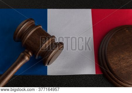 Justice Mallet On France Flag Close Up. Constitutional Law. French Legislation.
