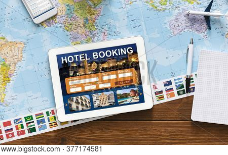 Hotel Booking Background. Digital Tablet With Application For Travel Accommodation Search Lying On D