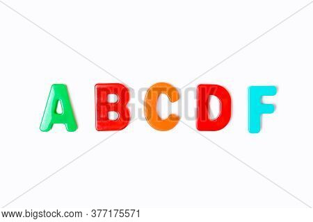 School Grades From Multi-colored Letters On A White Background. A, B, C, D, F. Concept Of Learning A