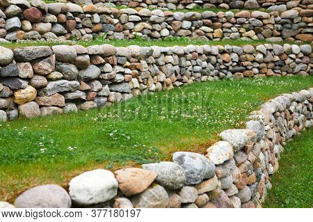 Grass And Flowers With Stone Masonry On The Leveled Front Yard. Landscape Design.