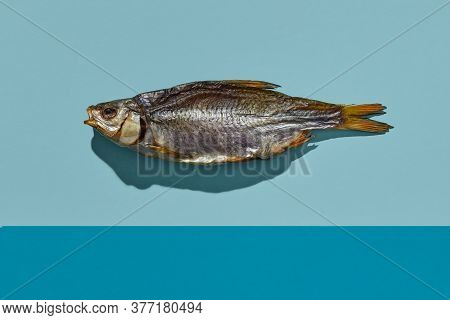 Dried Or Jerky Salted Roach, Palatable Clipfish On Colorful Background. Popular Beer Appetizer. Trad