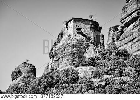 The Monastery of Agios Nikolaos in Meteora, Greece. Black and white greek landscape
