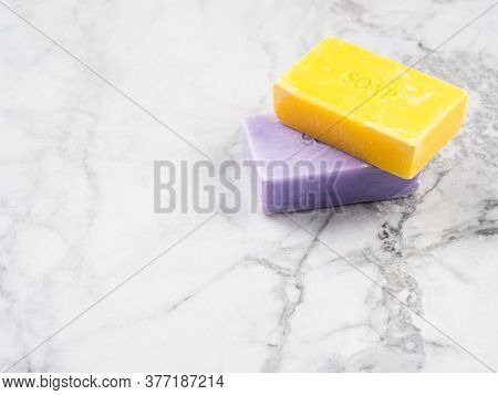 Lemon And Lavender Artisanal Soap Bars On Marble Table