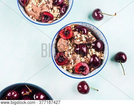 Delicious Chocolate Ice Cream Sundae With Cherries, Almond And Chocolate Sprinkles On Green Turquois