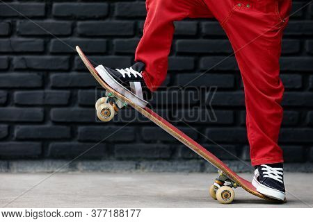 Young Skater With Skateboard Have Fun At Children Training Class In Skate Park. Active Family Lifest