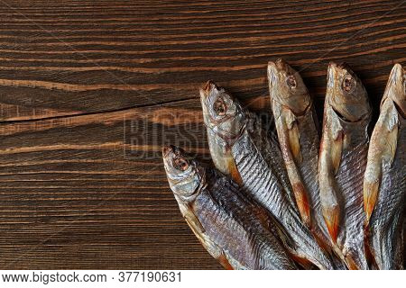 Dried Or Jerky Salted Roach, Clipfish On Wooden Background. Salty Beer Appetizer. Traditional Way Of