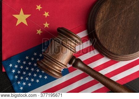 Judge Gavel Over Usa Flag And China. Trade War Between China And The United States. Legal Fight.