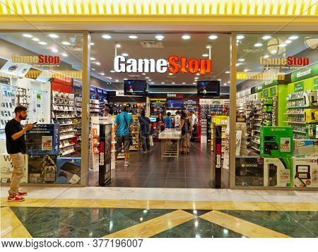 Rome, Italy - June 21, 2015. Gamestop Store In Rome, Italy With People Shopping. Gamestop Is An Amer