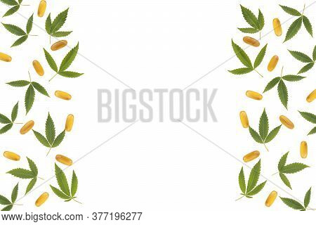 Frame With Cannabis Leaves And Oil Capsules Isolated On White Background. Cannabis Pattern With Copy