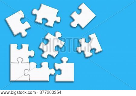White Puzzle With Shadows On A Blue Background. Design Concept. Copy Of The Space.