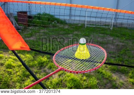 A Racket With A Shuttlecock And A Net To Practice Badminton. Summer Active Game