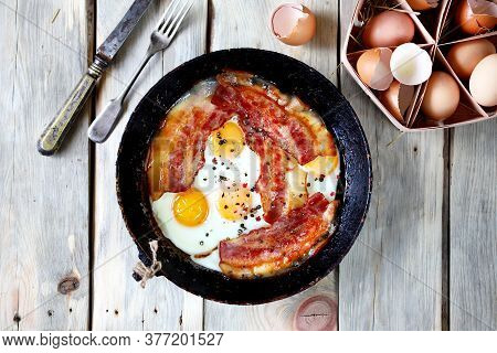 Selective Focus. Eggs With Bacon In A Frying Pan. Rustic Style. Traditional English Breakfast. Keto
