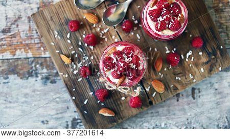 Selective Focus. Coconut Yogurt In Jars With Raspberries And Raspberry Jam. Healthy Vegan Dessert. R