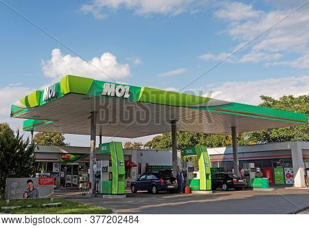 Galati, Romania - September 14, 2015. Mol Gas Station With Fueling Car. Mol Group Is An Integrated O
