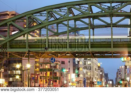 Akihabara Electric Town, Tokyo, Kanto Region, Honshu, Japan - April 15, 2010: Train On Elevated Brid