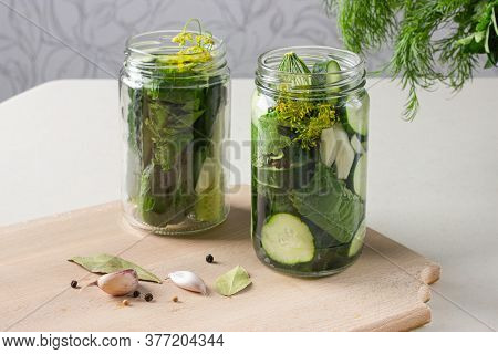 Jars With Pickled Cucumbers With Garlic, Horseradish And Pepper. Canned Vegetables.
