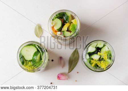Jars With Pickled Cucumbers With Garlic, Horseradish And Pepper. Canned Vegetables. Top View. Light