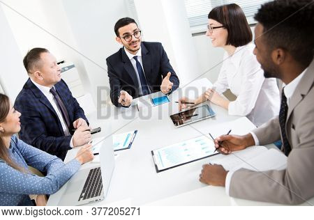Multy-ethnic group of business people working at the office desk