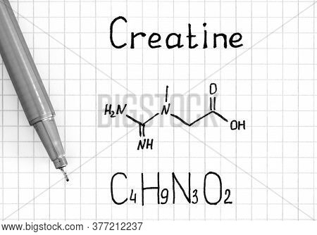 Chemical Formula Of Creatine With Pen. Close-up.
