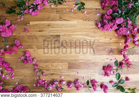 Pink Roses On Brawn Wooden Background, View From Above