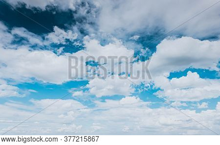 Blue Sky White Fluffy Clouds Background. Beautiful Blue Sky And White Cumulus Clouds Abstract Backgr