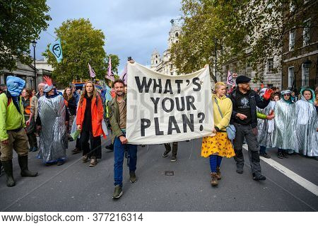 London - October 18, 2019: Climate Change Protesters Carrying A Protest Banner At An Extinction Rebe