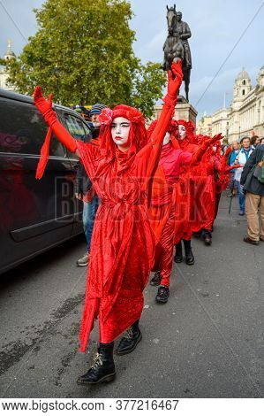 London - October 18, 2019: Full Length, Vertical Shot Of Red Brigade Protesters At An Extinction Reb