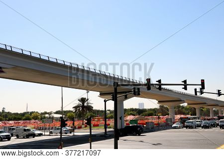 Country- Dubai, Date 07/20/2020 View Of Traffic Light And Vehicle Passing Under Flyover( Bridge)