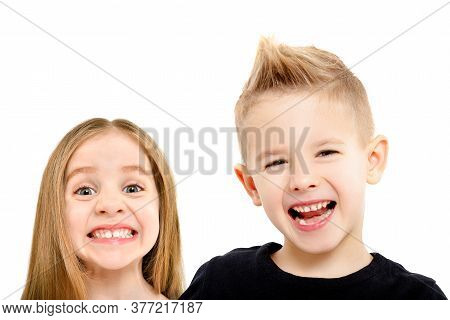 Portrait Of Cute Smiling Children Isolated On White Background