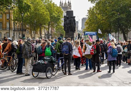 London - October 18, 2019: Extinction Rebellion Protesters Surround The Women Of World War Ii Monume